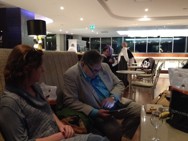The Chairman reviewing the restaurants in Negombo at Gatwick prior to departure. He can't wait to Sea Food and eat it.